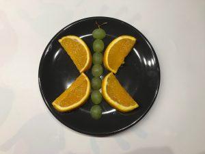 Monkey platter lunch voor kinderen vlinder van druiven fruit traktatie